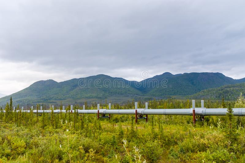 Trans-Alaska Pipeline System in Alaskan wilderness. View of the massive Trans-Alaska Pipeline System designed to move crude oil from the Prudhoe Bay all the way stock photo