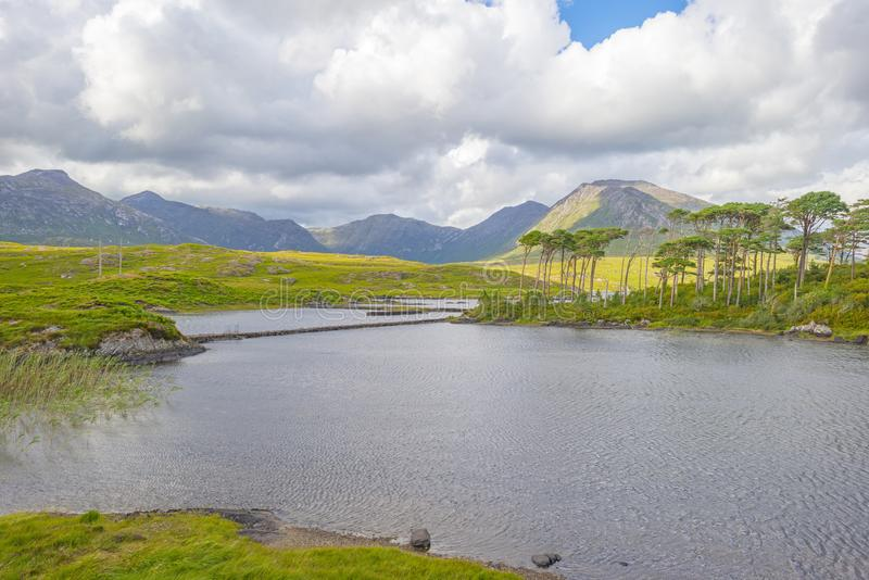 View of the meadows, lakes and mountains of the region Connemara in Ireland stock photography