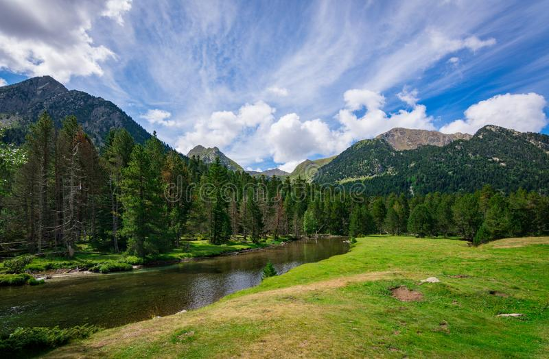 View of the meadows and peaks of the Aiguestortes National Park, Lleida, Pyrenees, Catalonia stock image