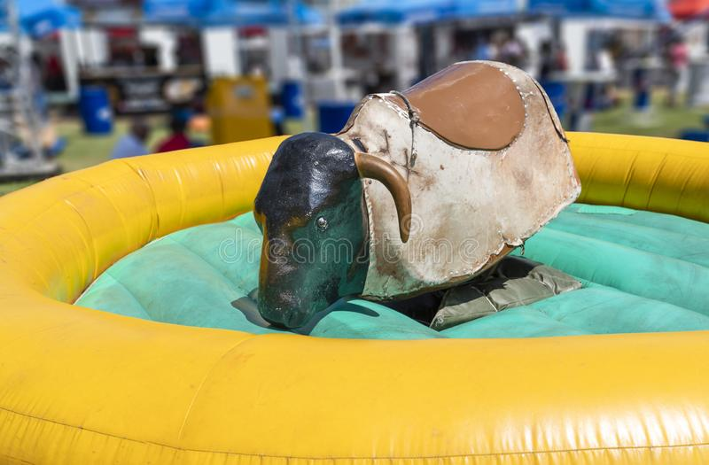 View of a mechanical bull machine with nobody stock photography