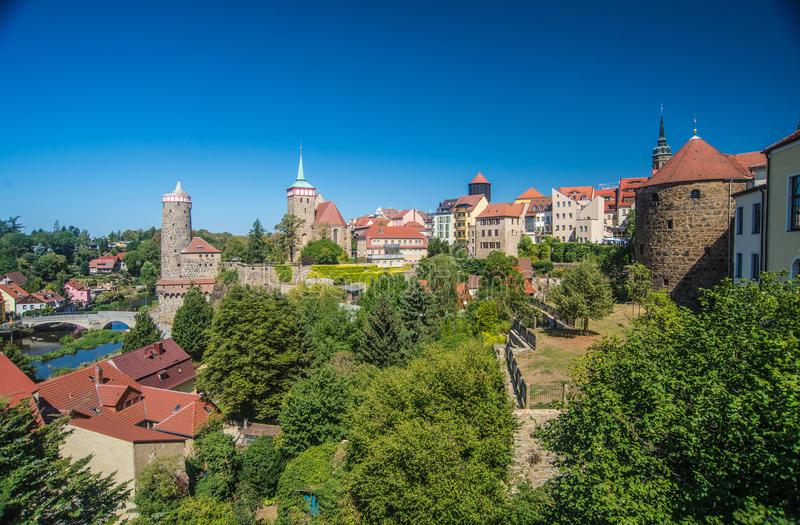 Medieval town panorama of Bautzen, eastern Germany. View of mediaeval town of Bautzen in eastern Germany in hot summer weather. Old stone bridge over Spree river royalty free stock photo