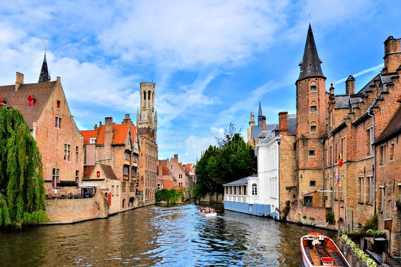 Medieval canals of Bruges, Belgium with bell tower. View of the medieval canals of Bruges, Belgium with famous bell tower royalty free stock photography
