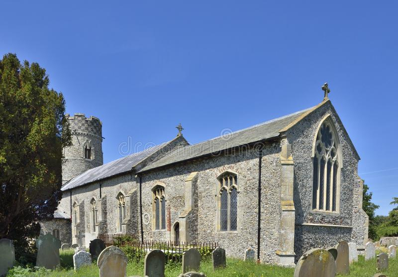 Historic Church and Graveyard of East Anglia. View of the medieval church and graveyard of St. Mary, Haddiscoe, South Norfolk, England royalty free stock photography
