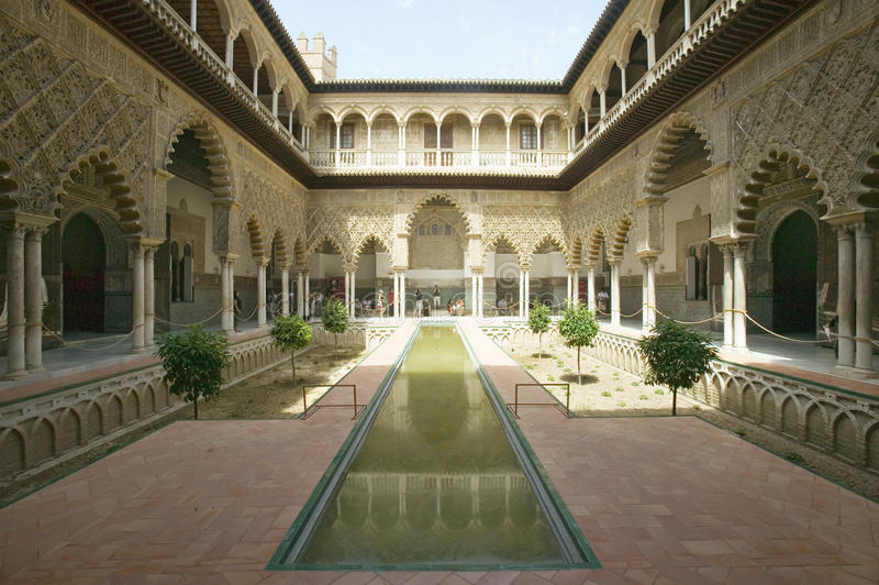 View of the Medieval garden and courtyard, the Patio de las Doncellas, of the Royal Palace, Sevilla, Spain, dating back to the. 9th century stock photo