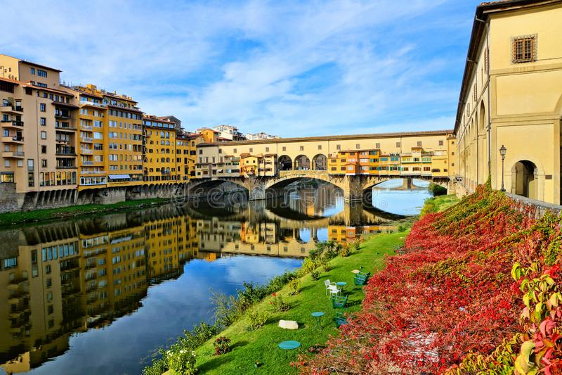 Medieval Ponte Vecchio with reflections during autumn, Florence, Tuscany, Italy royalty free stock photo