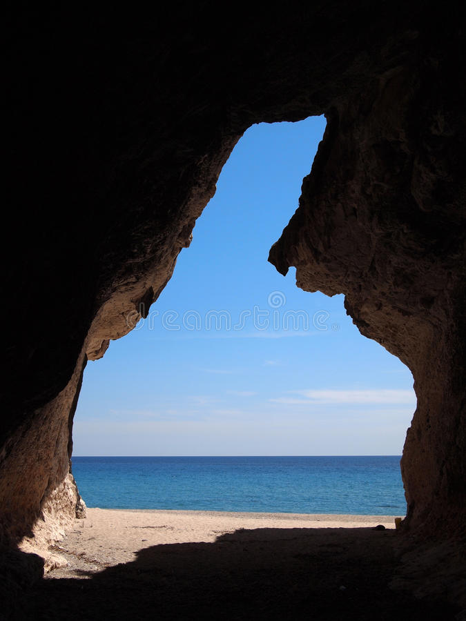 Beach cave with view on the sea stock image