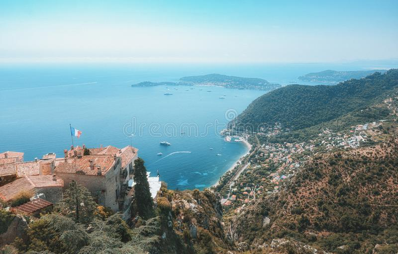 View on the Mediterranean Sea over the roofs of the picturesque medieval village of Eze with the Saint-Jean-Cap-Ferrat peninsula royalty free stock photo
