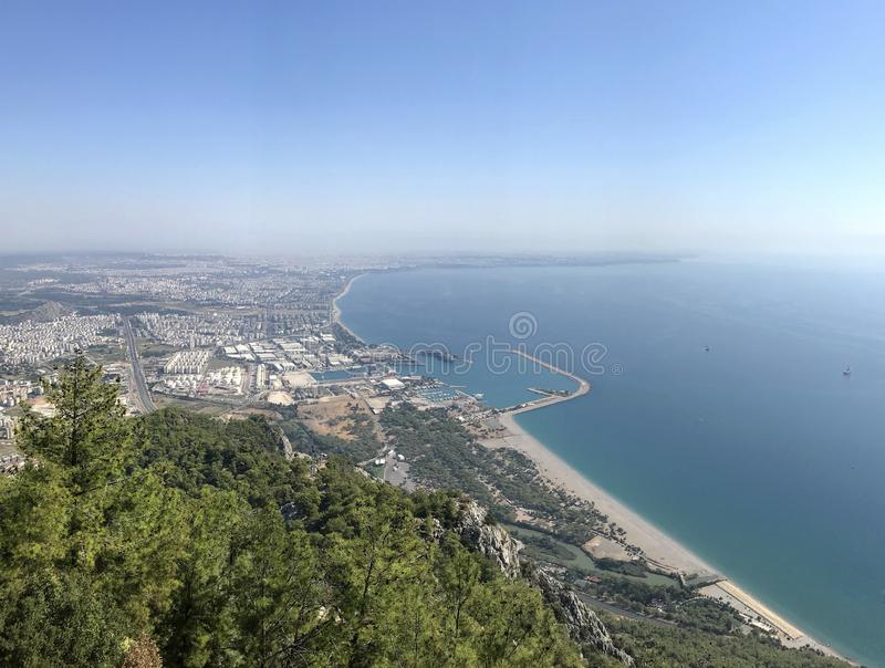 View of the Mediterranean Sea, the port and the city from above. On a sunny day in the region of Antalya, Turkey royalty free stock photography