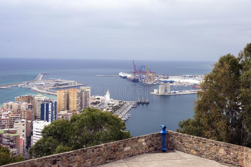 View of the Mediterranean Sea and the port of Malaga from the walls of the Gibralfaro fortress. Buildings, ships, port cranes. Spain, Andolusia royalty free stock photography