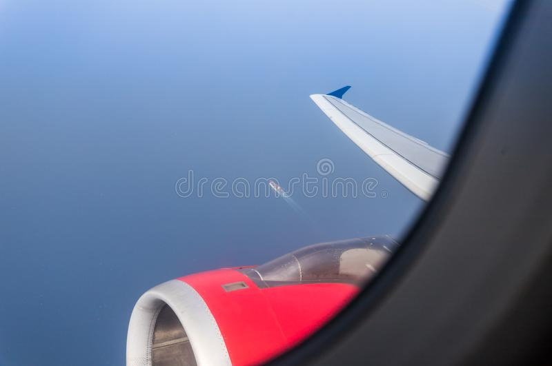 View of the Mediterranean Sea, the wing of the aircraft and the engine of the aircraft from the illuminator of flying airplane. View of the Mediterranean Sea royalty free stock photo
