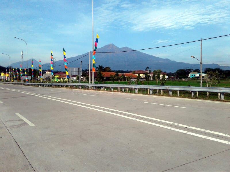View Merbabu and Merapi Mountain From Salatiga Toll gate royalty free stock photography