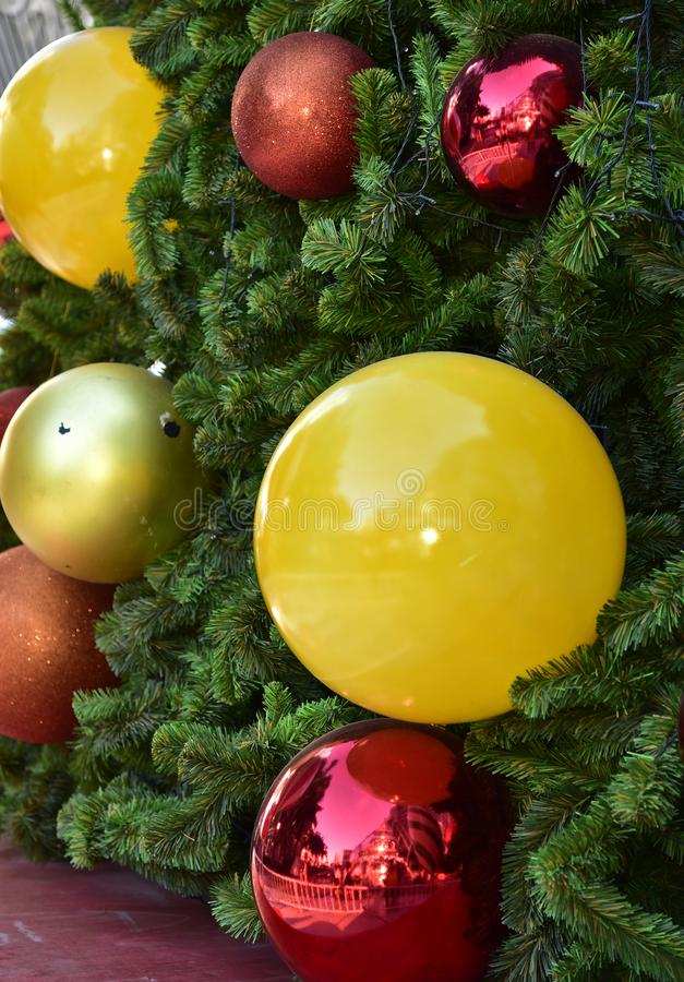 Closeup red bauble Christmas tree Gift Box balloon star royalty free stock photos