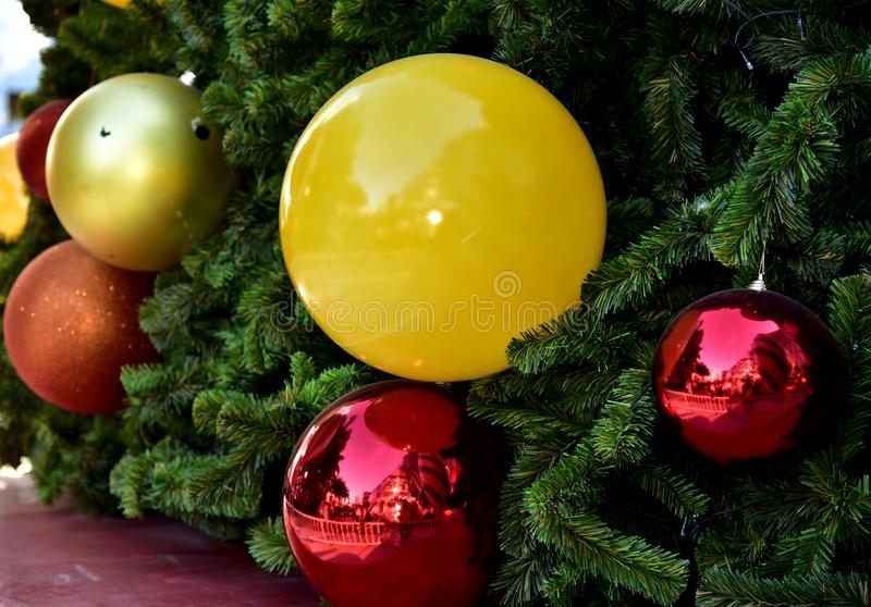 Closeup red bauble Christmas tree Gift Box balloon star royalty free stock photography