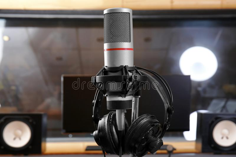 View of microphone with headphones. In radio station royalty free stock image