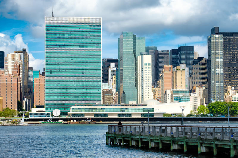 View of the midtown Manhattan skyline including the United Nations building. View of the midtown Manhattan skyline across the river from Queens including the royalty free stock photography