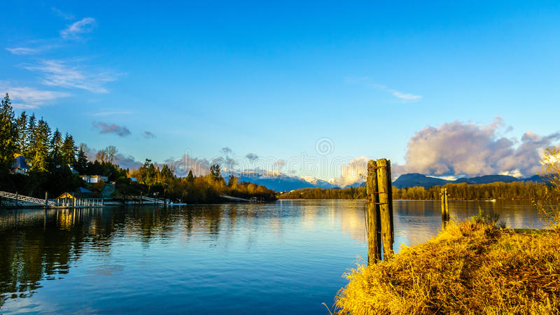 View of the mighty Fraser River in BC Canada. Beautiful view of the Fraser River on a sunny winter afternoon as seen from the historic village of Fort Langley stock images