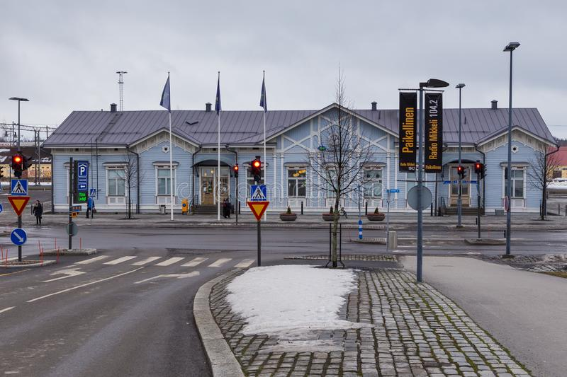 View of the Mikkelin train station. Wooden, blue building in the center of the city, Mikkeli, Finland. Mikkeli, Finland-03 March 2015 : View of the Mikkelin royalty free stock photo