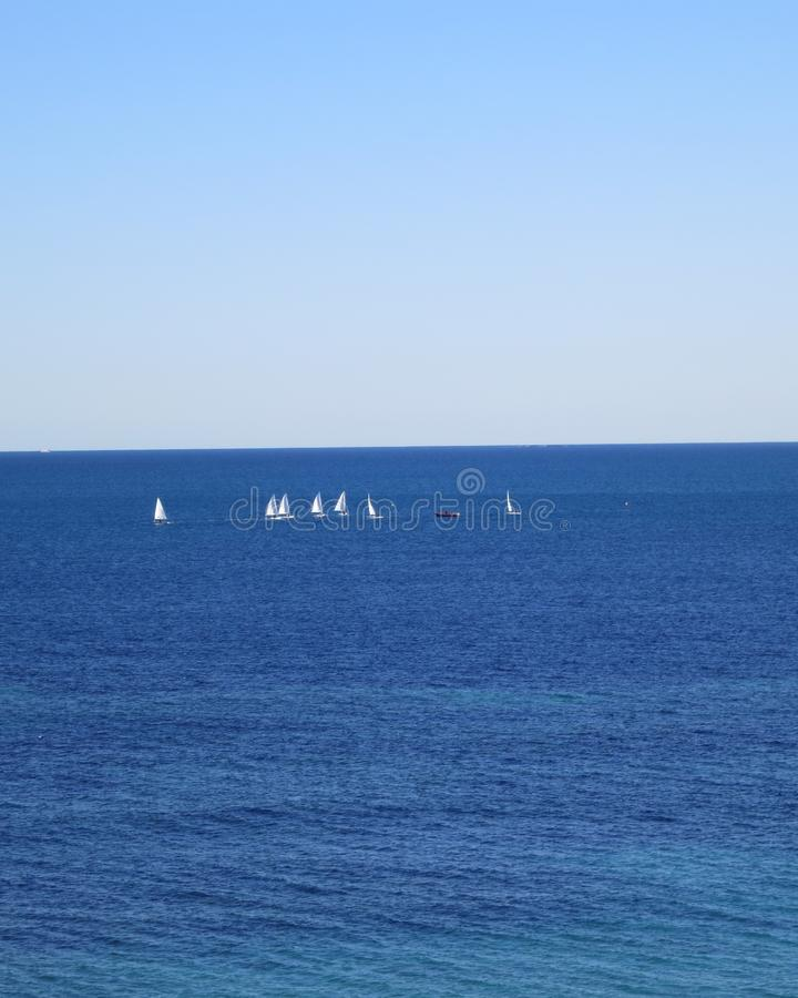 View from Mil Palmeras where you can see the Mediterranean with small sail-boats on the sea. Beautiful blue colors a lovely day in Mil Palmeras, Costa Blanca stock images