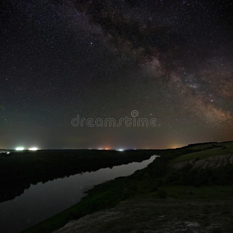View of the Milky Way over the river. Bright stars of the night sky. Astrophotography with a long exposure stock images