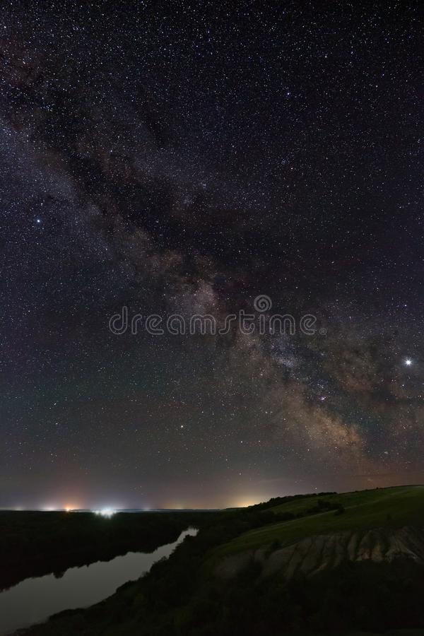View of the Milky Way over the river. Bright stars of the night sky. Astrophotography with a long exposure.  stock photos