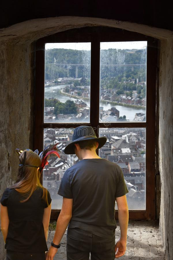 Teenagers in front of murky window with view on the river royalty free stock photo
