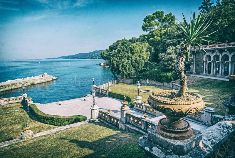 View from Miramare Castle near Trieste, analog filter. View from Miramare Castle near Trieste, northeastern Italy. Travel destination. Analog photo filter with royalty free stock photos