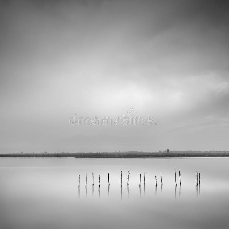 View of Missolonghi lagoon with wooden pillars royalty free stock photo