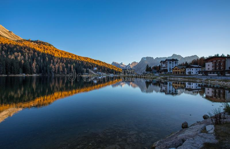 View of Misurina lake just after sunset. Sorapiss mountain on the background. Dolomites, Italy. stock images