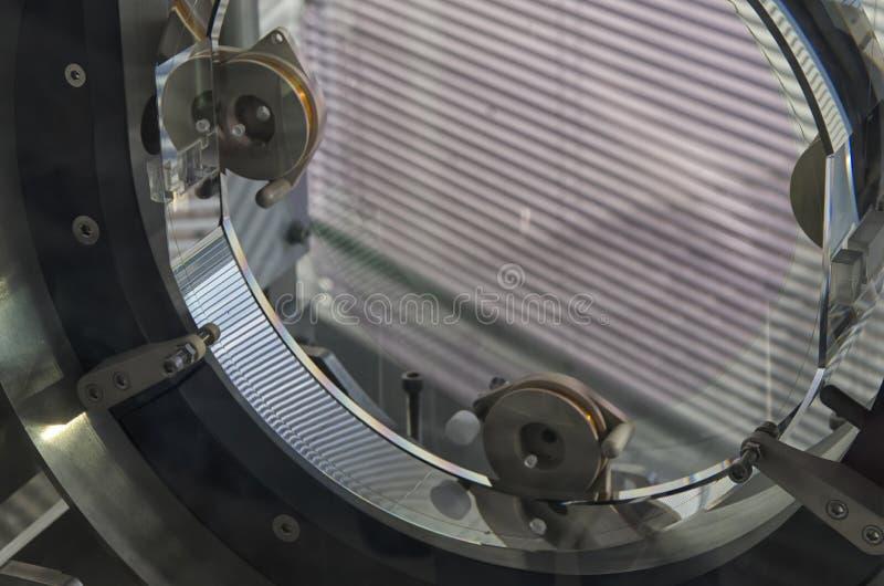 Model of Virgo interferometer mirror. View of a model of Virgo interferometer mirror stock photos