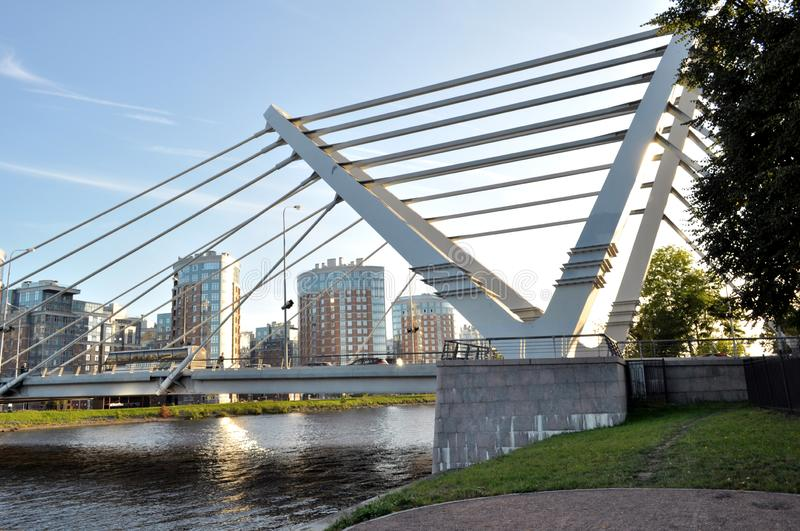 View of a modern bridge in a modern area of the city. It can be used in banners, posters, for printing on fabric, bag, mug,. Calendar, as background, etc royalty free stock photo