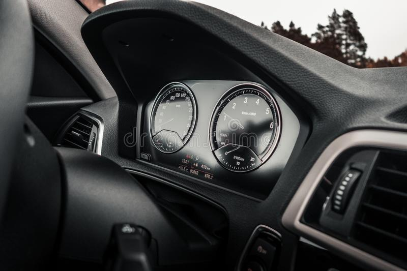 View from modern car instrument panel with gauges royalty free stock photo