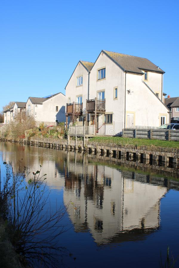 Canal side housing, Lancaster canal, Lancaster UK. View of modern housing at the side of the Lancaster canal in the Freehold area of Lancaster, Lancashire, UK royalty free stock images