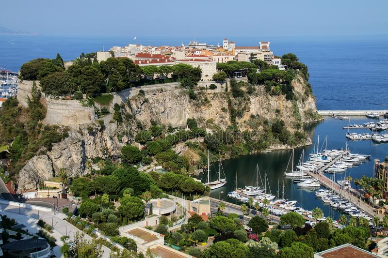 View of Monaco City and boat marina below in Monaco. Monaco City is one of the four traditional quarters of Monaco royalty free stock images