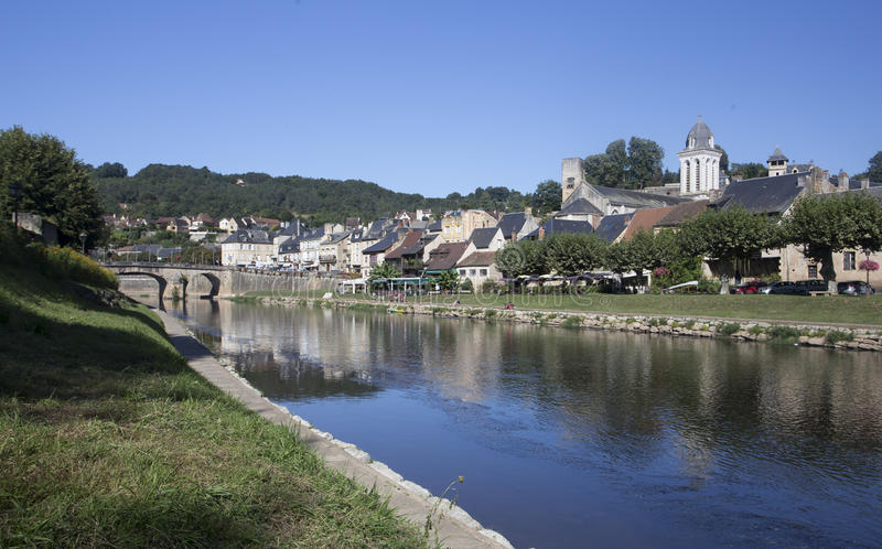 View of Montignac from the South Bank of the river. On the south bank of the river Vézère towards the old part of the town of Montignac showing the church stock photo
