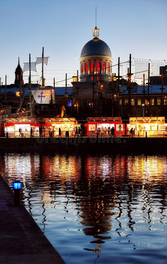 View of Montreal old port and the dome of bonsecours market at night stock image