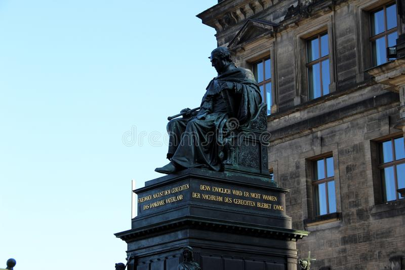 View on a monument near a historical building in dresden sachsen germany. Photographed during a sightseeing tour on a summer day royalty free stock photo