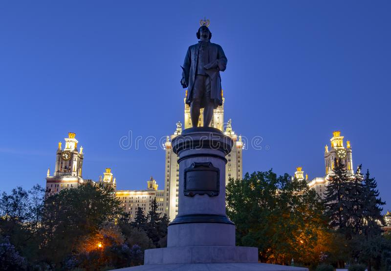 View of the monument to Mikhail Vasilyevich Lomonosov from the side of the main building of Moscow State University. MSU on Sparrow Hills at night, Russia stock image