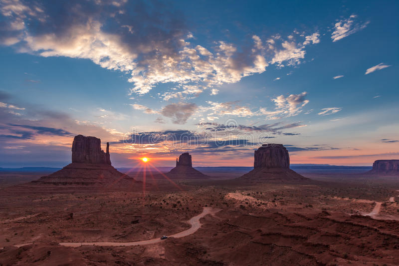 Sunrise in Monument Valley. View of Monument Valley, USA, at sunrise with Mittens and Merrick Buttes, Spearhead Mesa right in distance stock photo