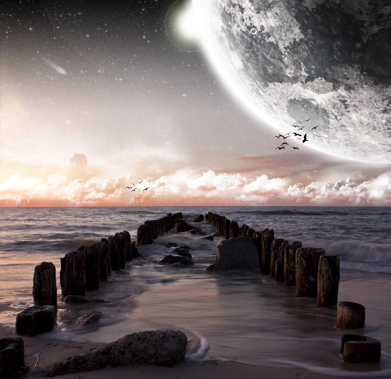 View Of The Moon From A Beautiful Beach Stock Photos