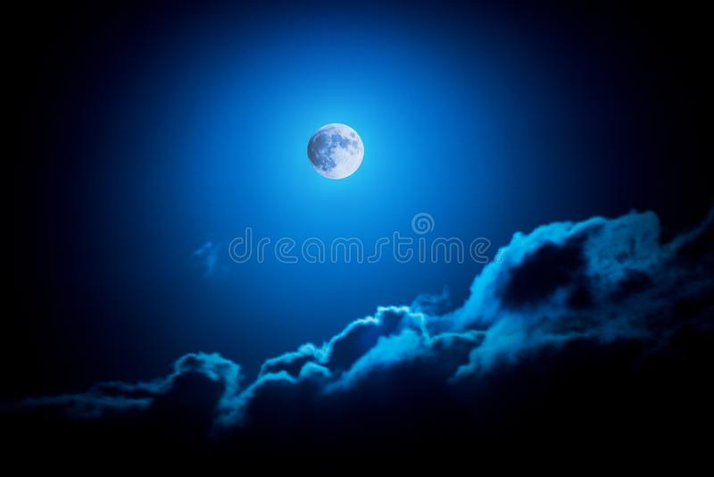 The moon - blue romantic representation with clouds royalty free stock photos