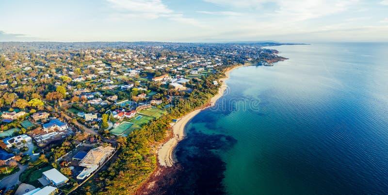 View of Mornington Peninsula coastal suburbs. Bird`s eye view of Mornington Peninsula coastal suburbs and Port Phillip Bay at sunset. Melbourne, Australia royalty free stock image