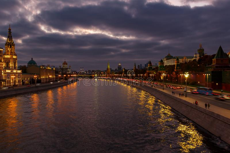 View of Moscow Kremlin and Moskva river embankments in evening against cloudy sky royalty free stock photo