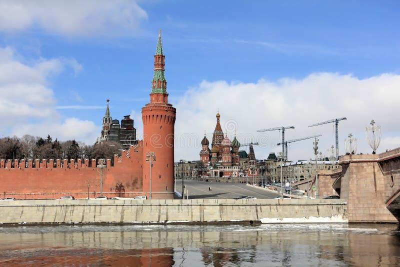 View of the Moscow Kremlin, Vasilyevsky Spusk Vasilyevsky Descent and St. Basil`s Cathedral from the Sofia Embankment. In the center is the Beklemishevskaya stock image