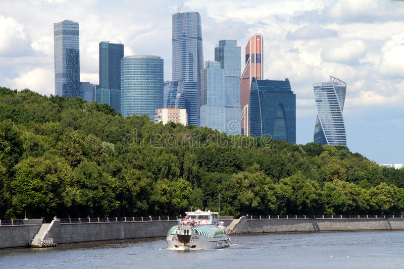 View of Moscow river, pleasure boat and Moscow International Bus stock photography
