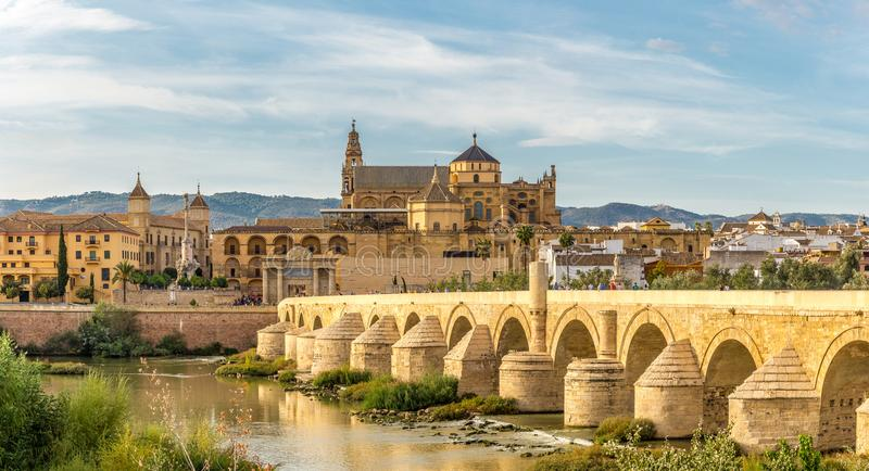 View at the Mosque - Cathedral with Old Roman bridge in Cordoba,Spain stock image