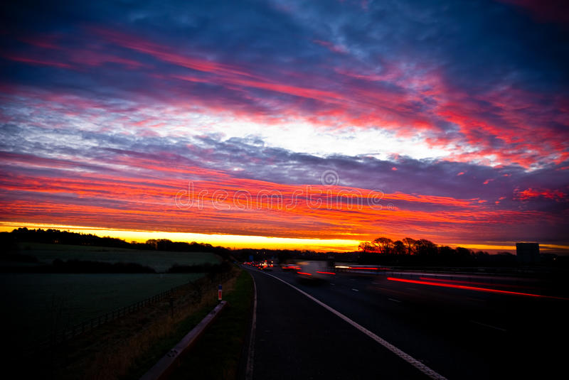 View from motorway with beautiful evening sunset royalty free stock photo