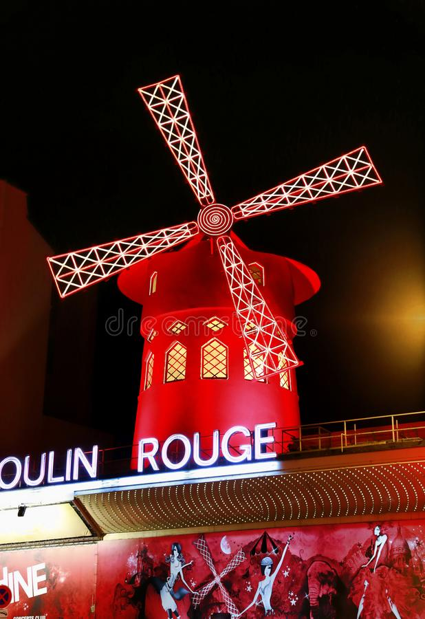 View of the Moulin Rouge Red Mill at night in Paris, France royalty free stock photography