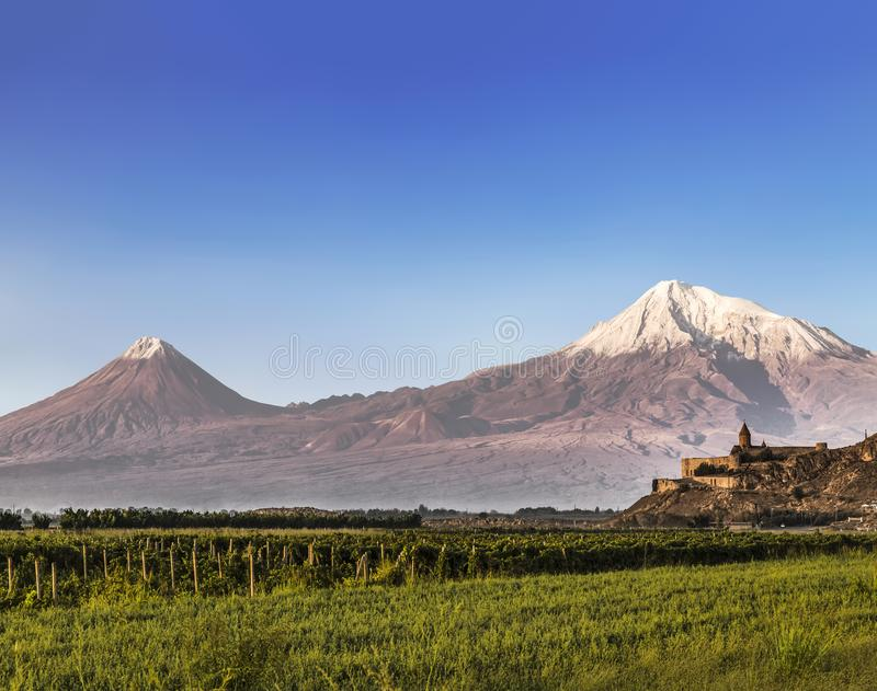 View of mount Ararat from Armenia and the monastery of Khor Virap. With vineyards in the foreground royalty free stock image