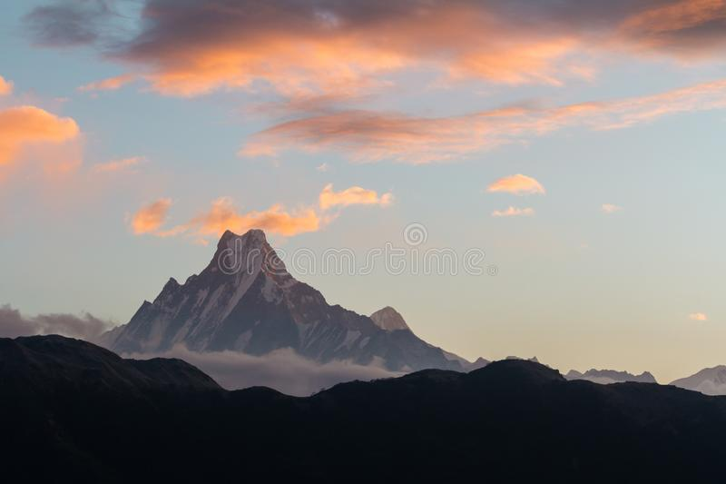 View of Mount Machapuchare from Nepali meaning `fishtail` from Poon Hill 3210 m on sunrise, Annapurna Conservation Area,. View of Mount Machapuchare from Nepali royalty free stock image