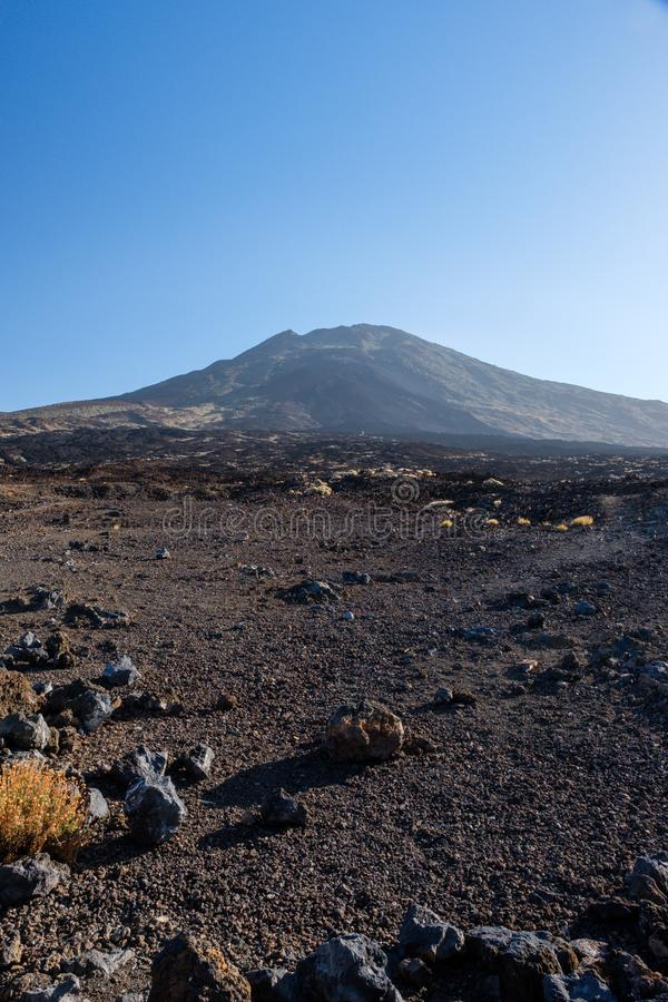View on Mount Teide across the volcanic lava fields. Early moring view on Mount Teide on Tenerife island across the lava palin stock image